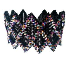 "Another lovely geometric peyote ""rickrack"" cuff."