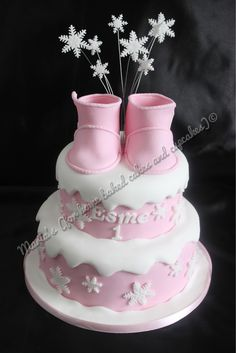 Children's Birthday Cakes - A winter themed cake with sugar paste UGG baby boots
