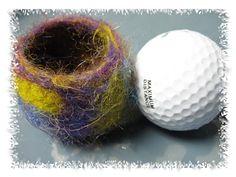 the treadler dot blogspot dot com: Tutorial: Wet Felting a Vessel.  I never considered using a golf ball!