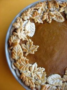 Pumpkin pie with fall leaves crust