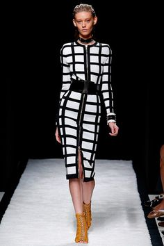 Balmain Spring 2015- A favorite of mine in Paris Olivier Rouesting did not disappoint with his outing of gridlock prints and cutouts. The use of primary colors in stripes and the black & yellow and black & white color blocking kept the looks grounded in a collection full of sexy silhouettes. thestyleweaver.com