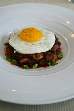 New York Pastrami Hash with onions, potatoes and roasted pepper sauce.