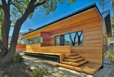 Clear cedar gives the renovated section a contemporary look that still fits in with the original stylings