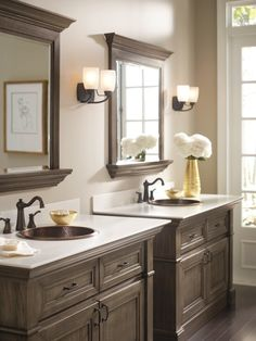Beautiful twin vanities. Love the copper sinks and bronze hardware.