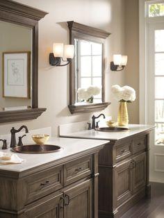 Beautiful twin vanities. Love the copper sinks and bronze hardware.