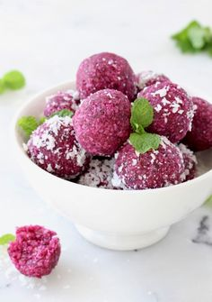 Easy, healthy no bake coconut date balls that are plant-based, vegan and good for you. A mix of sweet dried dates, organic coconut, a pretty roasted beet for color and a touch of exotic vanilla extract | VeggieSociety.com @VeggieSociety