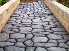 Cobblestone DIY paving using one Pavermaker mould (paving costs less than $10 per square metre) - any shape any colour.  See how to use the mould at www.pavermaker.com.  (DIY garden edging moulds also available at the website)