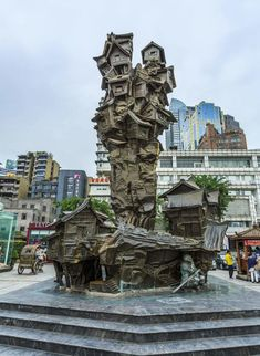 The Sculpture (洪崖洞雕塑) in showcasing the traditional stilted house complex of the city. Chongqing, China, Sculpture, Traditional, Architecture, House, Arquitetura, Sculpting, Haus