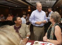 Democratic Senate nominee Doug Jones talked to supporters Jennifer L. Greer (right) and Janet Crosby (left) as he campaigns at Niki's West restaurant Wednesday in Birmingham, Ala.