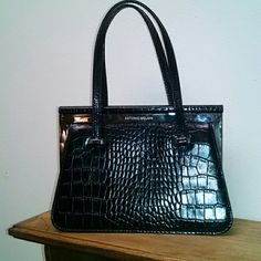Antonio Melani small black crocodile print purse. Black printed crocodile print purse.   It measures 8 inches wide and 5 inches in height.  Very sophisticated! ANTONIO MELANI Bags Mini Bags