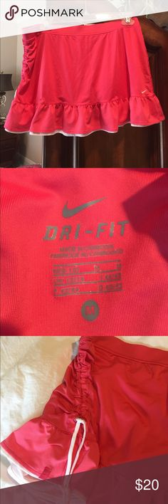 Nike Dri-Fit Tennis Skirt Fun pink tennis skirt. Ruffle bottom and side draw string. Used but in good condition Nike Skirts