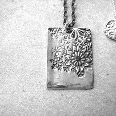 #Square #snowflake sterling #silver #necklace by #Designer Leisa Davies Like #snowflakes no two if these will ever be the same. This necklace features a #rustic snowflake pattern. This #snowy #charm measures approximately 15mm across and hangs from an 18″ sterling silver chain. My square snow charm is made entirely from #recycled Fine Silver (.999FS) _________________________________________________________________________ [...] Snowflake Pattern, Sterling Silver Necklaces, Dog Tag Necklace, Snowflakes, Handmade, Passion, Rustic, Jewelry, Snow Flakes