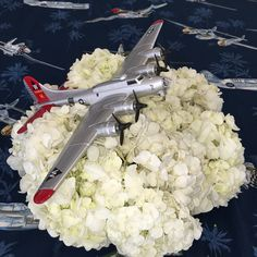 Airplane in the clouds centerpiece. B-17 model airplanes available at Lyon Air Museum. Centerpiece - hydrangea- flowers - airplane party lyonairmuseum.org
