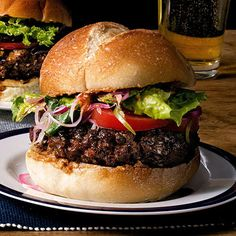 Sur Burger Chef and Latin-American food expert Maricel Presilla combines spicy Spanish chorizo with ground beef seasoned with cumin and cayenne. Then she layers on a pureed chile-walnut spread, jalapeño-onion relish and greens.  Restaurant: Cucharamama in Hoboken, NJ