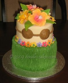 Hula Skirt cake with hibiscus flowers, coconut bra « Doodle-Cakes.com