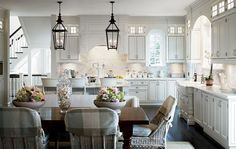 Coastal: Hamptons style white kitchen with dark timber floors and pendant lights