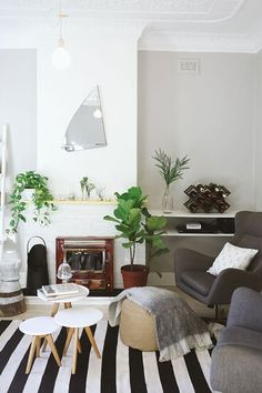 I like the idea of a graphic rug this winter,,, especially if everything else in the room is subdued