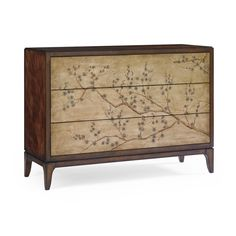 Chinoiserie chic! Graceful detailing that offers a powerful, jaw-dropping focal point for any room in the house. A brilliant marriage of masculine and feminine; old world and modern, this rich mahogany closed storage piece boasts a brilliantly gold leaf chinoiserie facade hand painted with delicate cherry blossom branches. Drawers offer touch latch closure. Beautiful shades of Swarovski crystals are strategically placed in the center of a few key blossoms so that the piece almost winks at…