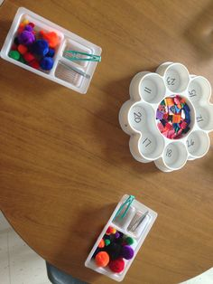 Counting buttons and practising fine motor skills.
