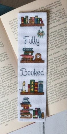 "Booked"" counted cross-stitch bookmark pattern by Fandom Cross-Stitchery., ""Fully Booked"" counted cross-stitch bookmark pattern by Fandom Cross-Stitchery., ""Fully Booked"" counted cross-stitch bookmark pattern by Fandom Cross-Stitchery. Cross Stitch Books, Cross Stitch Bookmarks, Cross Stitch Love, Cross Stitch Flowers, Cross Stitch Kits, Counted Cross Stitch Patterns, Cross Stitch Charts, Cross Stitch Designs, Cross Stitch Embroidery"