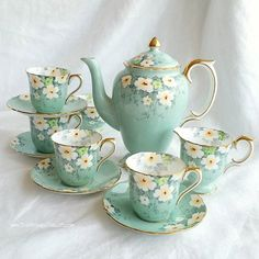 A gorgeous demitasse set by Crown Staffordshire. The details are handpainted, and they had survived both World Wars!