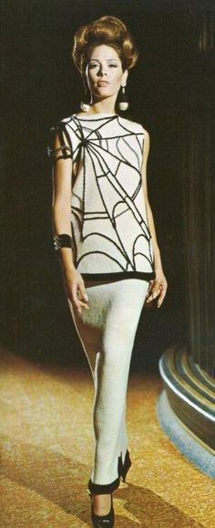 60s spider dress.   History of web dresses: https://lucianolapadula.wordpress.com/2017/10/31/spider-dresses-from-the-past/