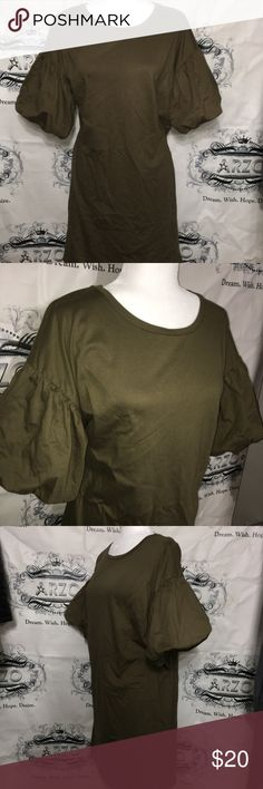 Olive Puff Sleeve Tunic Brand new. Tag says medium but it's cut big. I would say a person who wears a large or xl can fit this. I purchased for myself and I wear medium (6 / 36D) but it was two sizes too big for me. Dresses Mini