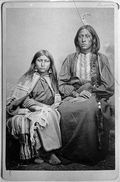 Trailing the Enemy with wife. Kiowa. 1870