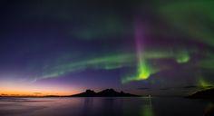 Multicolor aurora over sunset i northern Norway. Island Landegode just outside Bodø city.