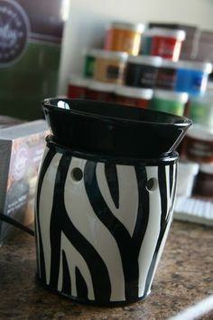 Scentsy Zebra Full Size Warmer for Kitchen or Any Room You Need a Nice Fragrance by Scentsy. $49.95. SCENTSY WARMERS ARE DESIGNED TO HEAT SCENTED WAX WITH THE USE OF A LIGHT BULB. SIMPLE AND/OR DECORATIVE WARMERS TO SCENT UP ANY ROOM. YOU WILL BE AMAZED WITH THIS PRODUCT. THIS ONE IS ESPECIALLY BEAUTIFUL - SCENTSY IS AWESOME! YOU MUST TRY IT TO BELIEVE IT. YOU WILL NEVER LIGHT ANOTHER CANDEL AGAIN. LEAVE ON 24 HOURS A DAY !   Zebra fullsize warmer