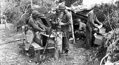 Members of the First Special Service Force preparing a meal in Anzio, Italy, in April 1944...