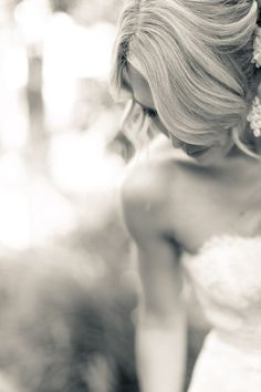 wedding hair >> rule of thirds, open shade, bride looking down, adjusting her dress, cropped near hips and very top of head