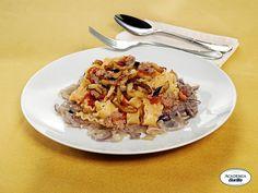 Reginette Barilla napoletane con salsiccia, melanzane e cipolla di Tropea caramellata