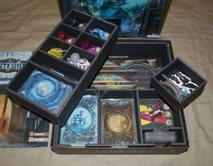 One of the biggest hits at Gen Con 2015, Mysterium actually comes with a fantastic insert. Like many other fantastic inserts, however, it does not fit sleeved cards. This solution holds the larger car