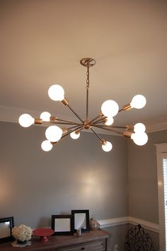"Neat dining or living room light. Mid Century ""spunik"" inspired chandelier.. via Etsy."