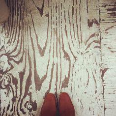 worn painted plywood flooring