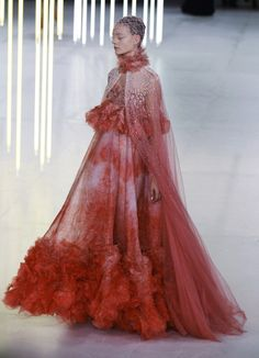 """Alexander McQueen S/S 2012 RTW """"This is a collection about excess. It's an exploration of ideals of beauty at their most extreme. We go to such lengths to adorn ourselves that we almost become our clothes or are taken over by them,"""""""