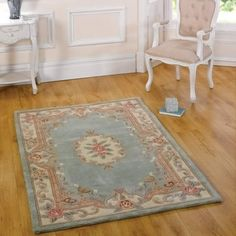 This Lotus Green Rug is made with full cut wool with a traditional design. It is a luxurious and has extra soft wool pile. Hall Runner, Green Wool, Traditional Rugs, Wool Rug, Lotus, Hand Carved, Classic Style, Runner Rugs, Stuff To Buy