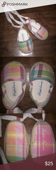 Authentic Ralph Lauren Newborn Shoes Excellent Used Condition Authentic Ralph Lauren Newborn shoes. These are so adorable on your little ones feet. They are plaid with a hemp like material around bottom. The laces tie around the ankle and have the Ralph Lauren logo on them. Ralph Lauren Shoes Baby & Walker