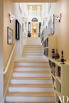 A stair hall, lined with bookshelves and illuminated by French Art Nouveau sconces, joins the old and new wings. Basement Steps, Staircase Design, Staircase Ideas, Couple Room, Entry Hallway, Next At Home, Architectural Digest, Humble Abode, Stairways