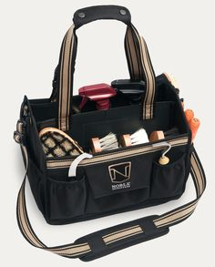 Noble Outfitters' EquinEssential Tote- Made from durable 600-denier, 100-percent polyester canvas fabric with water-repellant finish. Heavy-duty interior coating for easy care. Canvas exterior and plastic interior make the tote sturdy and multiple divided pockets keep your gear organized. The mesh bottom allows dirt to fall through and a detachable strap makes the tote extra-portable. $54.99. Visit Nobleoutfitters.com.