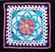 'Floral Accent'  12 inch square designed by James G. Davis from the Leisure Arts booklet '50 Fabulous Crochet Squares' by Jean Leinhauser & Rita Weiss. Stitched for Moogly CAL June12th, 2014.