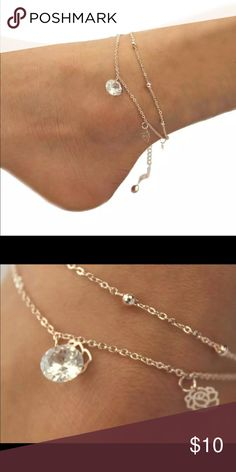 Flower Anklet Cute gold toned anklet with flower charms. This can clasp anywhere from 7 to 10 inches. New in package. Very cute! Jewelry
