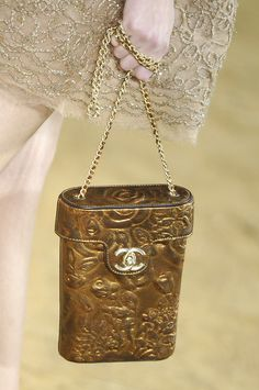 Chanel adorable little gold purse. I see that CC and I get excited. Chanel s 75785b9fbf4
