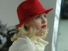 blond in red hat