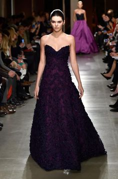 New York Fashion Week may be coming to an end, but Kendall Jenner is just getting started! The 19-year-old model looked striking in a dark purple strapless gown while strutting her stuff in the Fall 2015 Oscar de la Renta fashion show on Feb. 17, 2015 in New York.