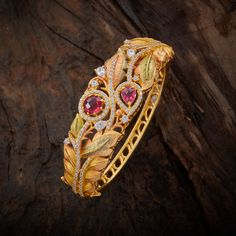 Classy Trendy Design CZ Zircon Kada studded with Ruby synthetic stones, with gold Polish. It Comes with Locking System.