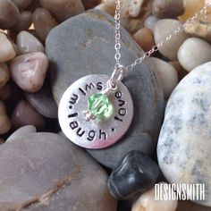 Swim, laugh, love handstamped pendant by DesignSmith. $35 rdesignsmith.com