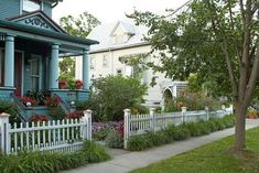 stately-house-white-picket-fence-red-flowers-f42f8ee0 Small Front Yards, Trees For Front Yard, Front Yard Decor, Small Front Yard Landscaping, Front Yard Design, Front Yard Fence, Outdoor Landscaping, Landscaping Plants, Landscaping Ideas