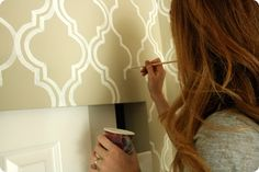 Painted wall w/ a homemade stencil... going to try this in the dining room!